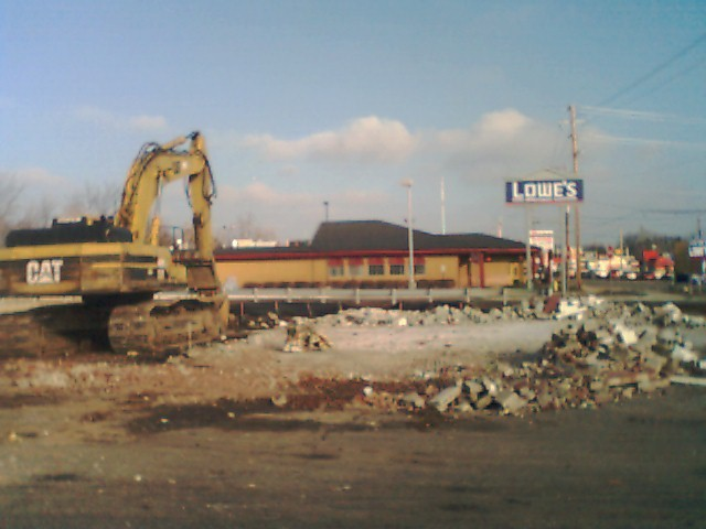 the remains of the old location, with the Lowe's sign in the background